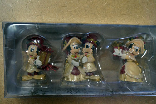 Victorian-styled Mickey and Minnie Christmas ornaments.