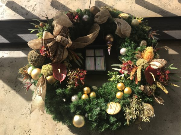 You can find Christmas details in many places.  This beautiful wreath is on the side of the ticket booths.