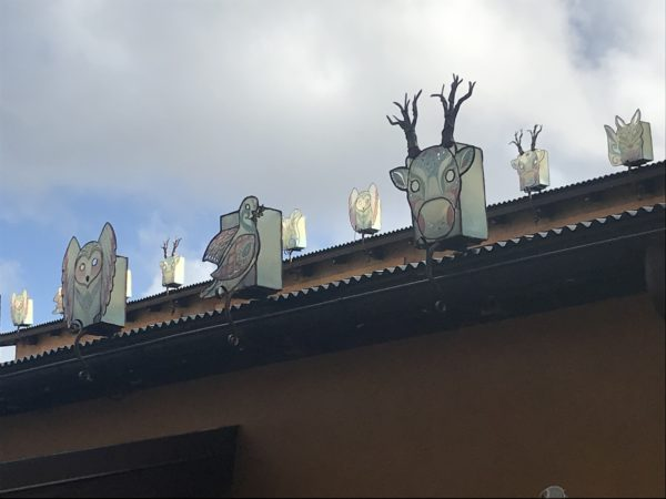 Animal decorations line the rooftops in Discovery Island.