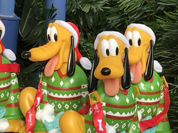 disney has released their new popcorn bucket its pluto in a christmas sweater holding a - Disney Christmas Decorations 2017