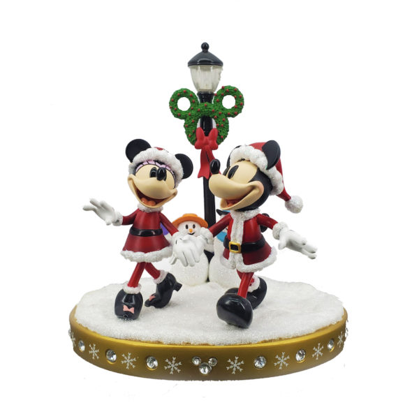Light-up figurine of Mickey and Minnie strolling through the snow. Photo credits (C) Disney Enterprises, Inc. All Rights Reserved
