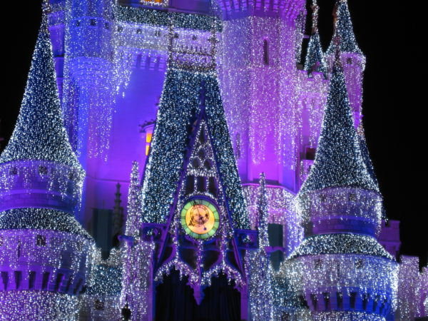 See Elsa and friends turn Cinderella Castle into an ice palace at Christmastime!