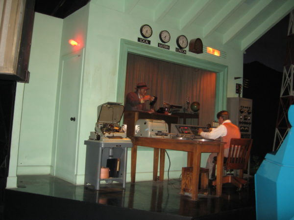 This scene in Spaceship Earth depicts an early radio broadcast, which is part of the larger story of the evolution of communication.