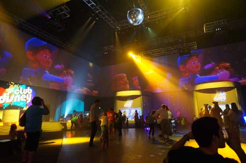 The party includes plenty of lights, videos, and techno-inspired Disney dance music.