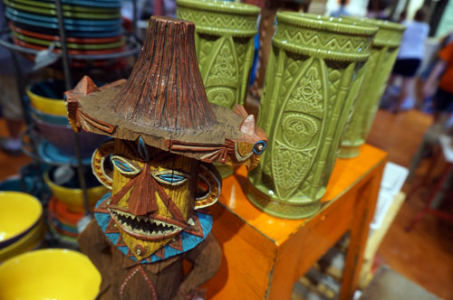 There is lots of Tiki merchandise on display.