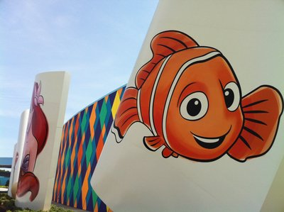 The main building has colorful drawings of popular Disney characters from the featured movies including Cars and Finding Nemo.