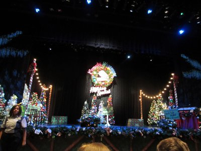 The stage for the show has a definite Christmas theme.