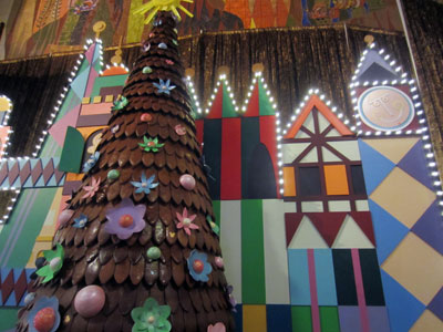 Huge gingerbread tree with a great backdrop inspired by Mary Blair.