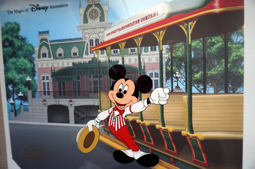 This art features Mickey Mouse on Main Street USA.
