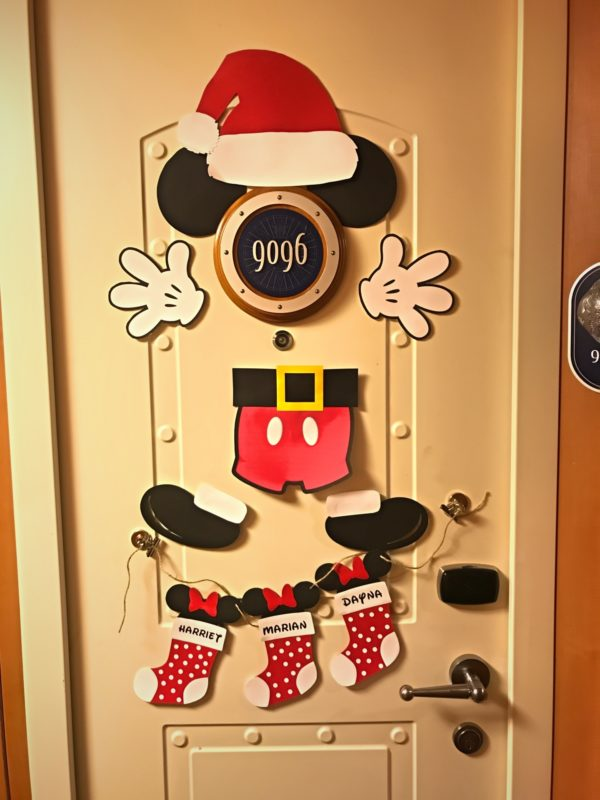 Santa Mickey is hanging out on this door! Have they been naughty or nice?