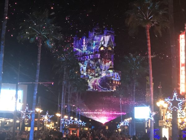 Holiday projections bring the Tower of Terror to life with Christmas scenes.