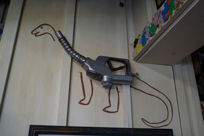 I like this gas pump handle that was turned into a dino.