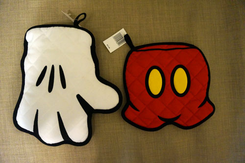 Mickey oven mitt and table protector.