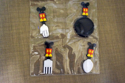 Mickey-inspired magnets of cooking utensils.