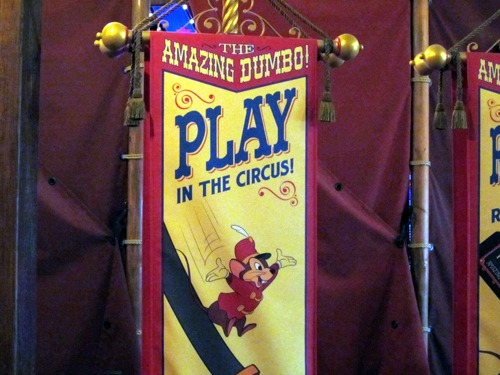 The circus-themed play area in the queue of Dumbo can entertain children while you're waiting for your elephant!