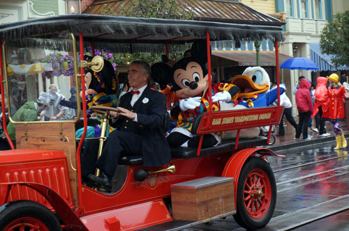 Usually a few characters ride down Main Street in covered vehicles.