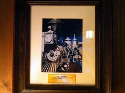 A photo of Walt was superimposed on a picture of the Lilly Belle steam engine to create this composite image. The Lilly Belle was one-eight-scale, so this trick photo demonstrates the great detail in the train.