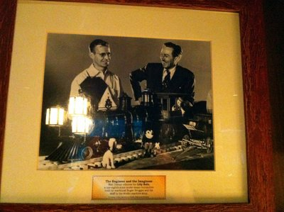 In this photo, Walt Disney is seen with machinist Roger Broggie who built the steam train.