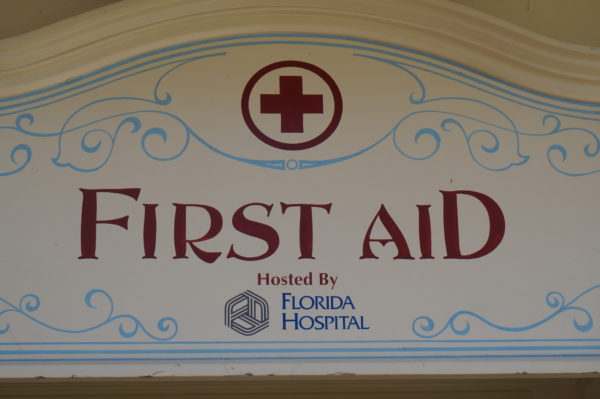 Every park has at least one first aid station with certified nurses who can offer advice and OTC meds. They can also order transportation to an urgent care or hospital should you need further medical attention.