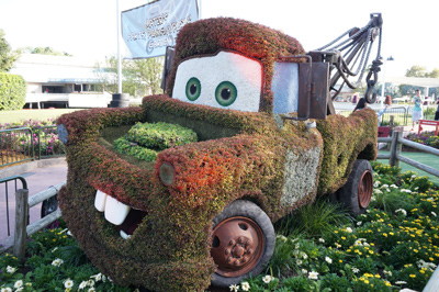 Tow Mater sits near a play area for kids.