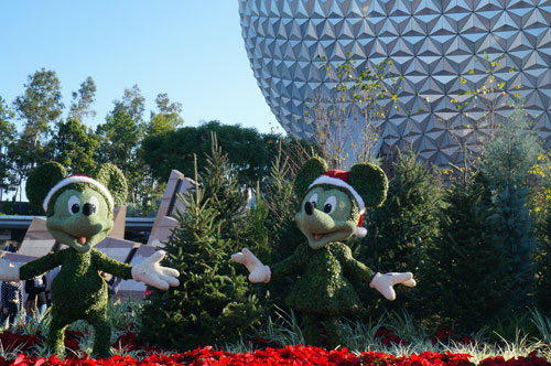 Mickey and Minnie Mouse topiaries at the park entrance.