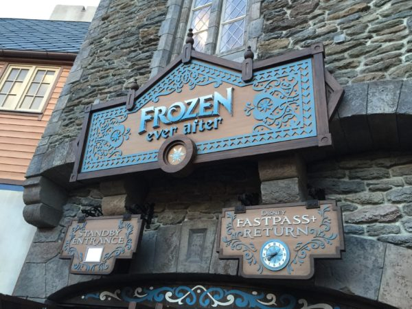 Long waits happen after this sign, but with some great Frozen scenery.