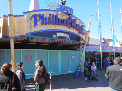 Get FastPass+ help to the right of the Philharmagic entrance.  The old FastPass machines are behind a construction wall for removal.