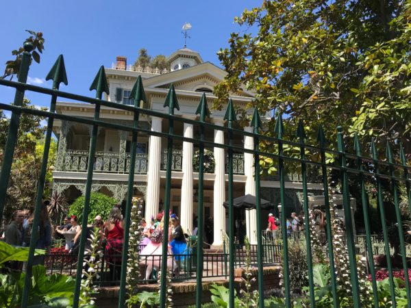The Disneyland version of Haunted Mansion is located in New Orleans Square, so the exterior of the mansion fits that theme.