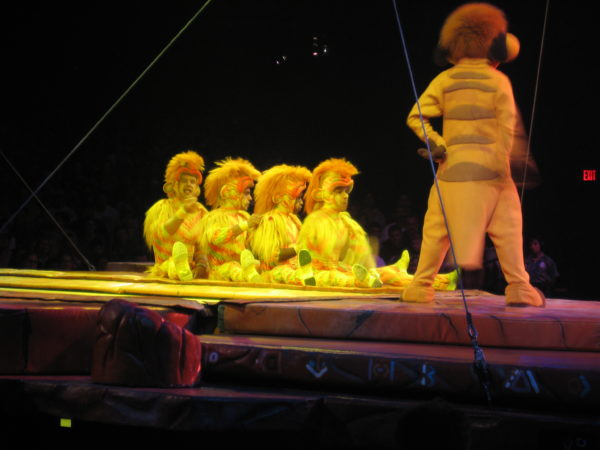 The Tumble Monkeys and Timone in the Festival of the Lion King show.