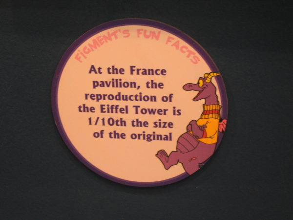 "Figment says, ""At the France pavilion, the reproduction of the Eiffel Tower is 1/10th the size of the original."""