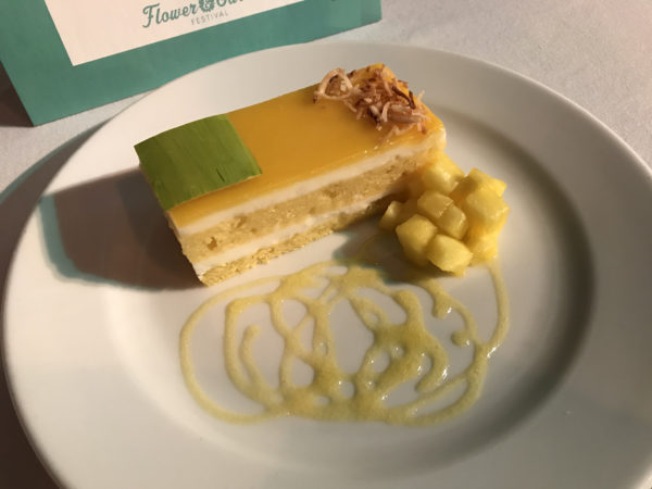 Tropical Mousse Cake: Layers of Passion Fruit Cake, Coconut Mousse and tropical fruit glaze with fresh pineapple