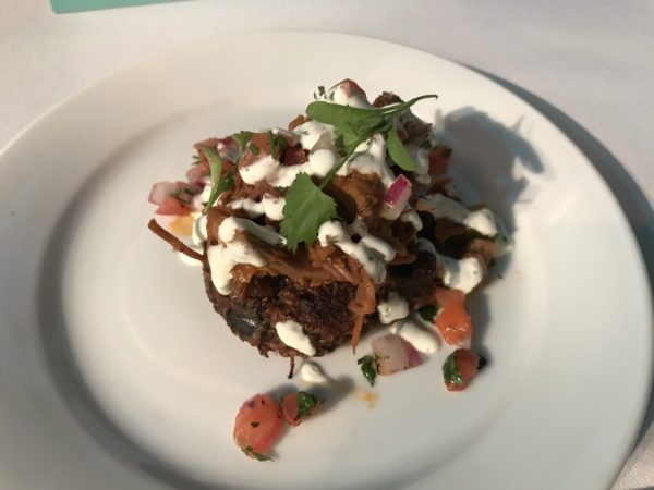 Carne Guisada with black bean cake and cilantro-lime sour cream