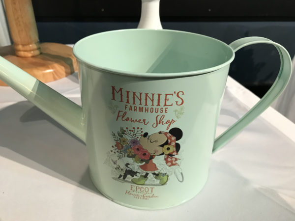 Minnie wants to help your garden grow with this perfectly pastel watering can!