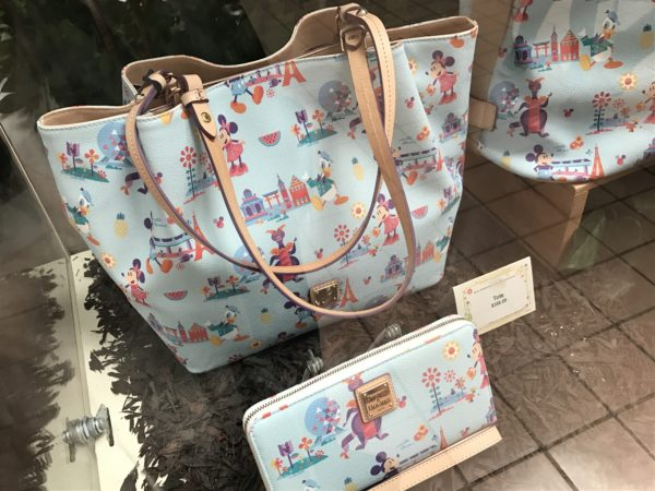 Carry your love of Epcot with you wherever you go with this Dooney and Bourke tote and wallet.