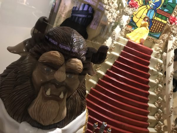 Beauty and the Beast are sculpted in chocolate inside Beast's castle.