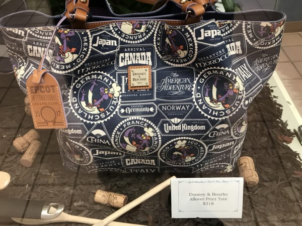 This Dooney & Bourke bag has a World Showcase theme, and you'll fit everything you need to travel the World in here!