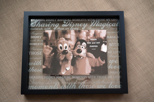 the first frame is finished in handsome black with etched wording on the glass - Disney Picture Frames