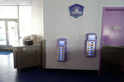 Two small machines contain lockers.