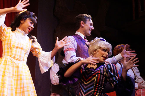 Sing, dance, and tell corny jokes in the Hoop Dee Doo Musical Revue.