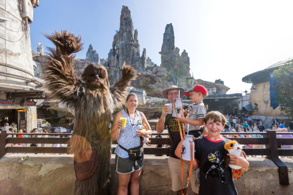 Eight-year-old Jonathan Ridgeway of Ocean Springs, Mississippi (front right) becomes the one millionth guest to take to take the controls of Millennium Falcon: Smugglers Run at Star Wars: Galaxy's Edge at Disneyland. Photo credits (C) Disney Enterprises, Inc. All Rights Reserved