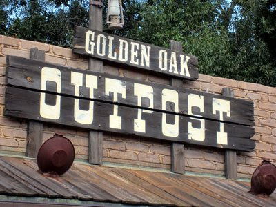 The Golden Oak housing development will offer fancy digs - very much not like this rustic sign from Frontierland.