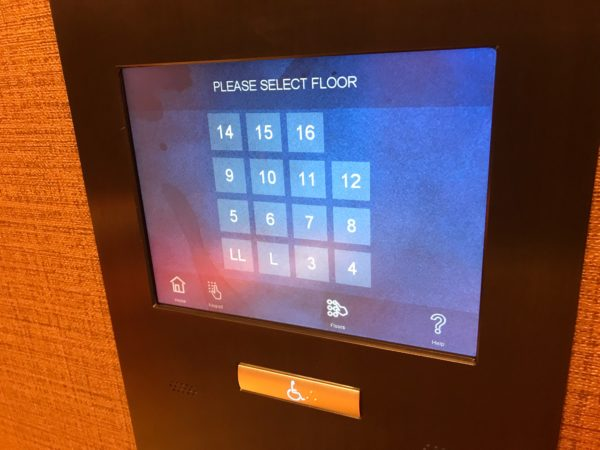 Select your desired floor on the elevator touch screen.