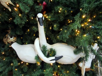 The swan ornaments add a Victorian touch.