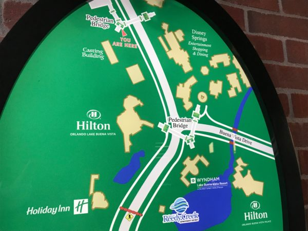 Directional sign that shows the location of the Grapefruit Garage and the nearby hotels and pedestrian bridges.