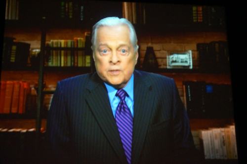 Robert Osborne appears in the movie that plays in the queue.
