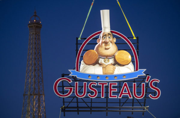 The Gusteau's sign is begin installed in the France pavilion at Epcot. Photo credits © Disney Enterprises, Inc. All Rights Reserved