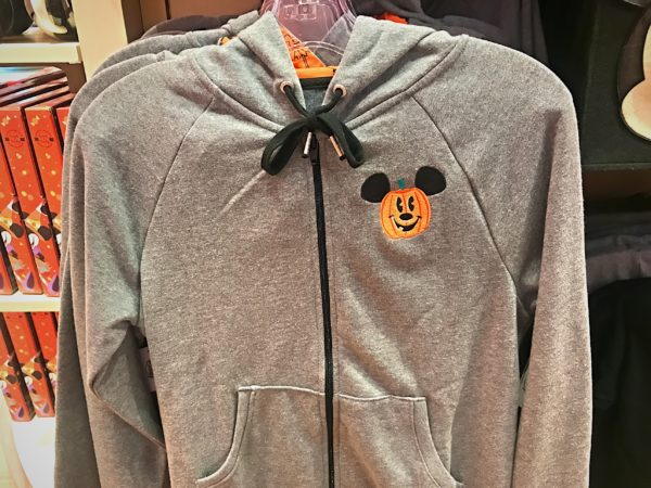 This cool Halloween hoodie features an orange liner and a Mickey head pumpkin for $54.99.