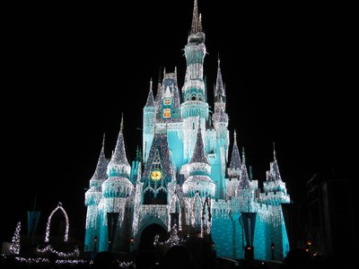 Cinderella Castle still changes color - and just looks a bit more magical at Christmas time with the Dream Lights.