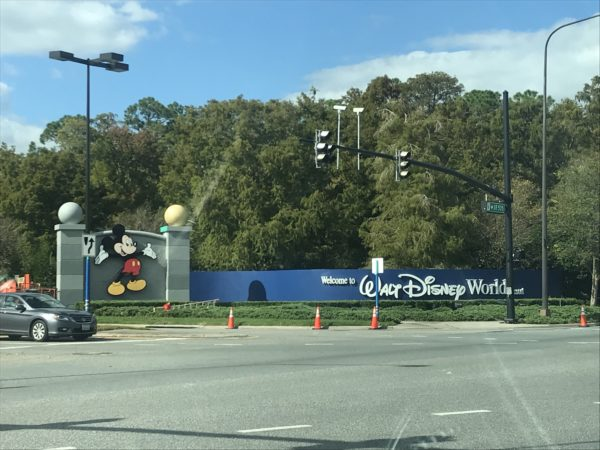 Disney has repainted the blue wall, and has painted the background behind Mickey Mouse a gray color.
