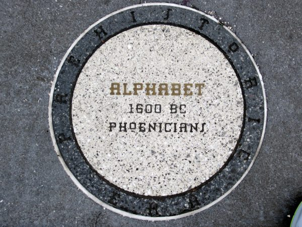 The Phoenicians created the alphabet in 1600 BC. There are dozens of alphabets in use today, whether letters or symbols, and the longest is the Cambodian Khmer alphabet, which contains 74 letters.  As we learn in Spaceship Earth, if you thought it was easy to learn your ABCs, thank the Phoenicians!